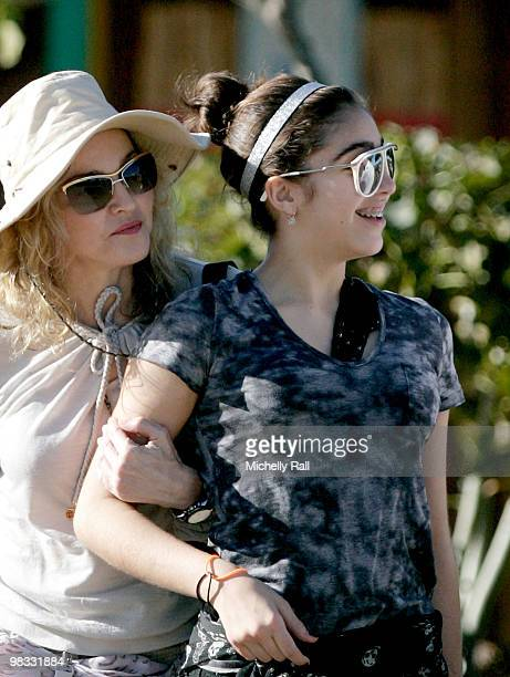Madonna arrives with daughter Lourdes at one of the Raising Malawi initiative's the Mphandula Childcare Centre which supports over 350 Children from...