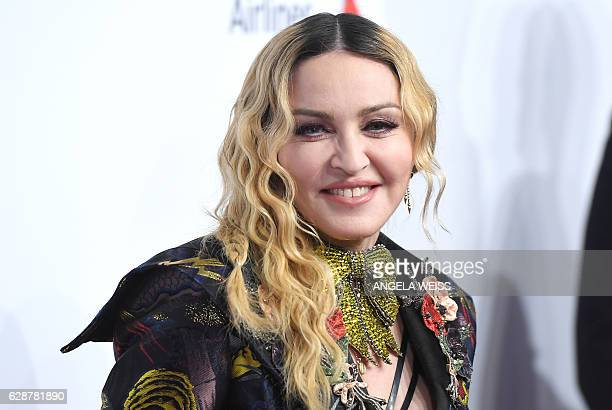 Madonna attends the Billboard Women in Music 2016 event on December 9 2016 in New York City / AFP / ANGELA WEISS