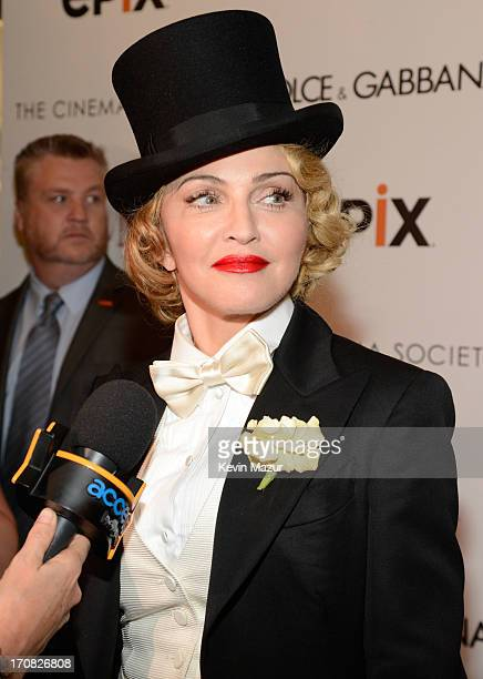 Madonna attends the Dolce Gabbana and The Cinema Society screening of the Epix World premiere of 'Madonna The MDNA Tour' at The Paris Theatre on June...