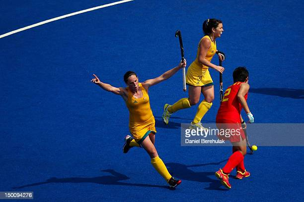Madonna Blyth and Jade Close of Australia celebrate a goal in the second half against China during the Women's Hockey classification match for 5th...