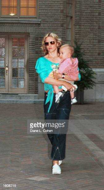 Madonna carries her son Rocco as they leave their apartment August 9 2001 in New York City Madonna was in New York on a day off from her current...