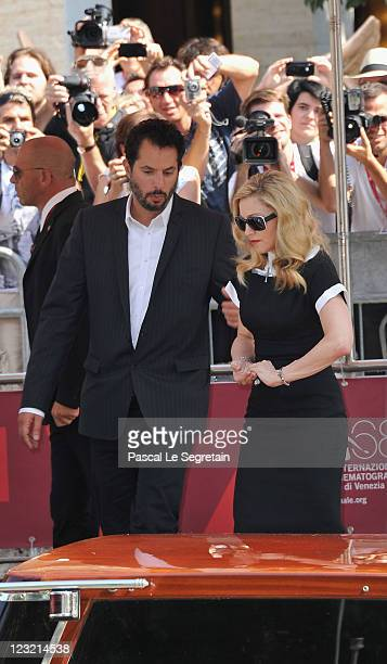 Madonna departs with her manager Guy Oseary from the'WE' photocall at the Palazzo Del Cinema during the 68th Venice Film Festival on September 1 2011...