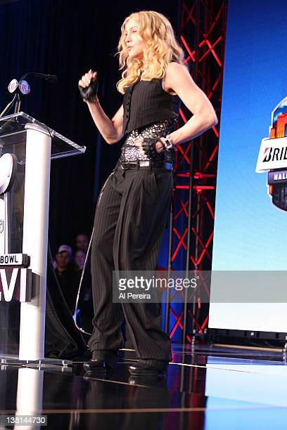 Madonna does the Victor Cruz 'Salsa Dance' when she attends the Bridgestone Super Bowl XLVI Halftime Show Press Conference at the Super Bowl XLVI...