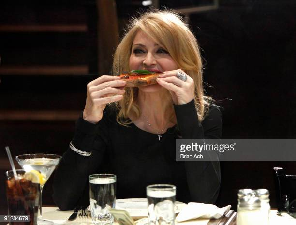 Madonna eats at Angelo's Pizza while she visits Late Show with David Letterman at the Ed Sullivan Theater on September 30 2009 in New York City