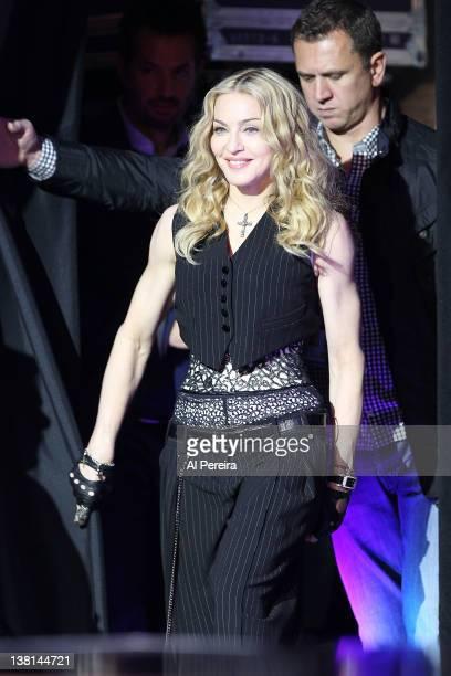 Madonna enters when she attends the Bridgestone Super Bowl XLVI Halftime Show Press Conference at the Super Bowl XLVI Media Center on February 2 2012...
