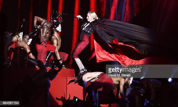 Madonna falls as she performs at the BRIT Awards 2015 at The O2 Arena on February 25 2015 in London England