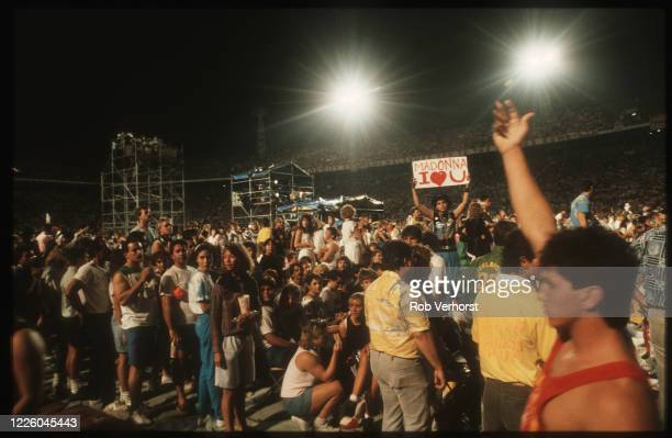 Madonna fans in the audience at the Orange Bowl Stadium, Miami, Florida, United States, during the Who's that Girl World Tour, 27th June 1987.
