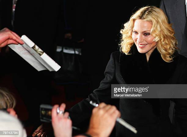 Madonna greets fans prior to the 'Filth and Wisdom' Premiere as part of the 58th Berlinale Film Festival at the Zoo Palace on February 13 2008 in...
