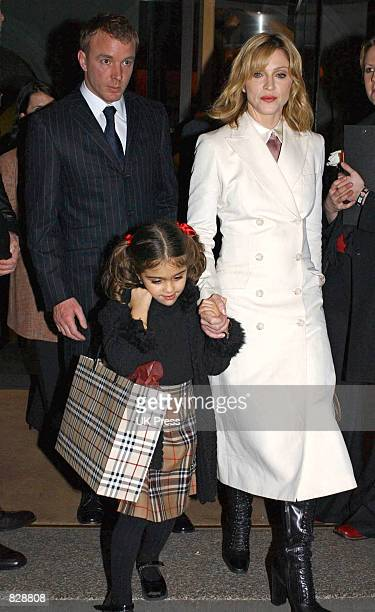Madonna her daughter Lourdes and husband Guy Ritchie arrive at the opening of the Mario Testino photography exhibition January 29 2002 at the...
