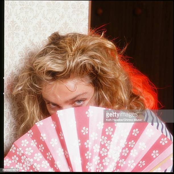 Madonna holding a fan in a hotel room Tokyo January 1985
