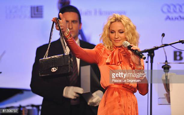 Madonna hosts the auction during the amfAR's Cinema Against AIDS 2008 benefit held at Le Moulin de Mougins during the 61st International Cannes Film...
