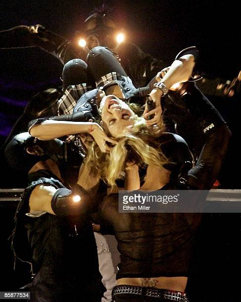 Madonna is carried by dancers as she performs during the first of two soldout shows at the MGM Grand Garden Arena during her Drowned World Tour...