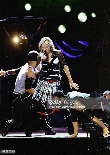 Madonna is in style kilts and bondage gear in the first of five Drowned World tour concerts at Madison Square Garden