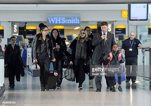 Madonna is seen at Heathrow airport with her children Rocco John and Mercy James on April 02 2011 in London United Kingdom