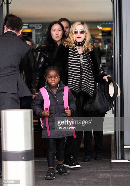 Madonna is seen at Heathrow airport with Mercy James on April 02 2011 in London United Kingdom
