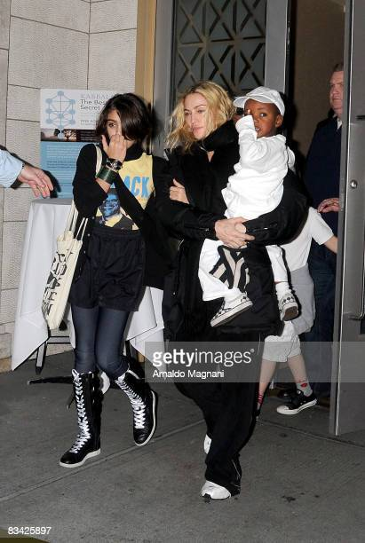 Madonna leaves a Kabbalah center with her daughter Lourdes Leon and her son David Banda on October 24 2008 in New York City