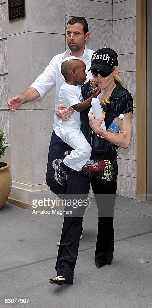 Madonna leaves Kabbalah with her adopted son David Banda October 1 2008 in New York City