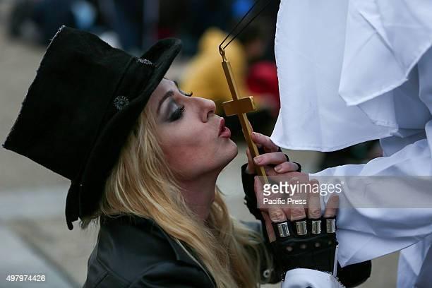 Madonna lookalike kisses a gold cross