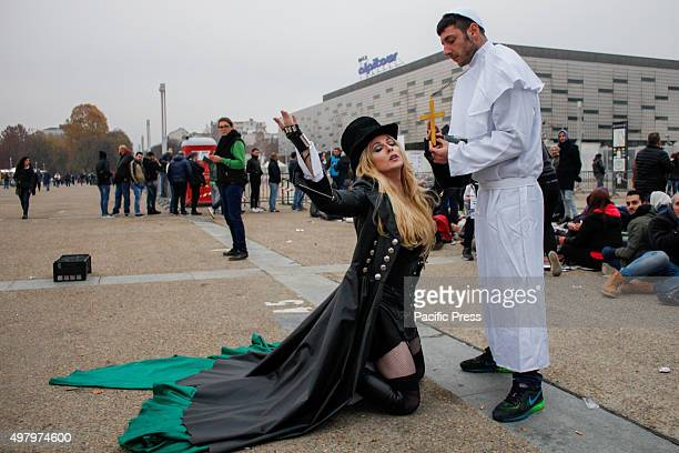 Madonna lookalike with the Brazilian cosplayer Rinaldo Borba dressed as pope poses for the photographer outside the arena where the singer Madonna...