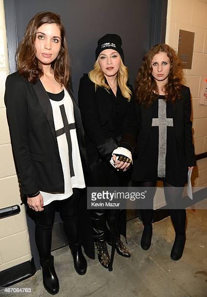 Madonna Nadya Tolokonnikova and Masha Alyokhina of Pussy Riot attend the Amnesty International Concert presented by the CBGB Festival at Barclays...