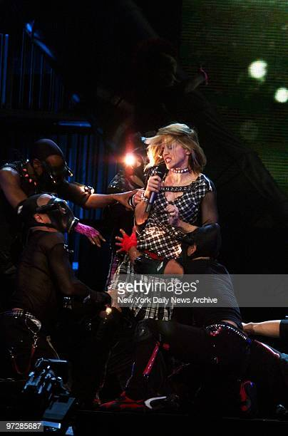 Madonna performs at the kickoff of the US leg of her 'Drowned World' tour at the First Union Center in Philadelphia
