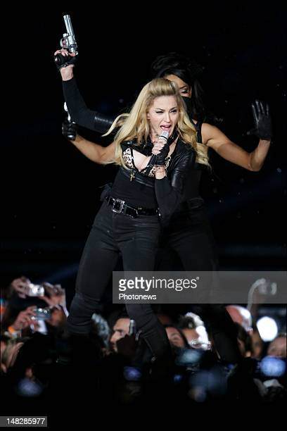 Madonna performs during her MDNA Tour at the Stade RoiBaudoin Stadium on July 12 2012 in Brussels Belgium