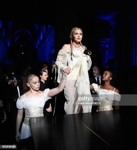 Madonna performs during the Heavenly Bodies: Fashion & The Catholic Imagination Costume Institute Gala at The Metropolitan Museum of Art on May 7,...