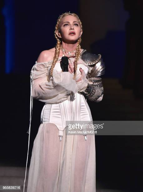 Madonna performs during the Heavenly Bodies Fashion The Catholic Imagination Costume Institute Gala at The Metropolitan Museum of Art on May 7 2018...