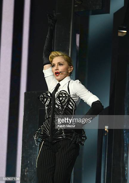 Madonna performs during the MDNA North America tour opener at the Wells Fargo Center on August 28 2012 in Philadelphia Pennsylvania