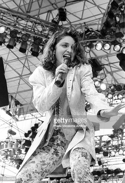 Madonna performs for a sold out crowd at the Live Aid concert at JFK Stadium in Philadelphia Pennsylvania July 13 1985 Photo by Frank...