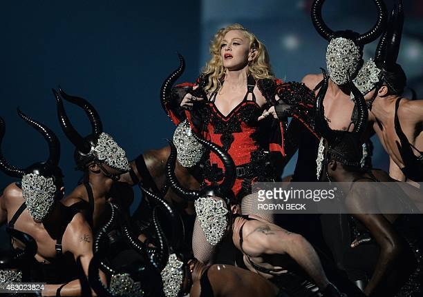 Madonna performs on stage at the 57th Annual Grammy Awards in Los Angeles February 8 2015 AFP PHOTO/ROBYN BECK