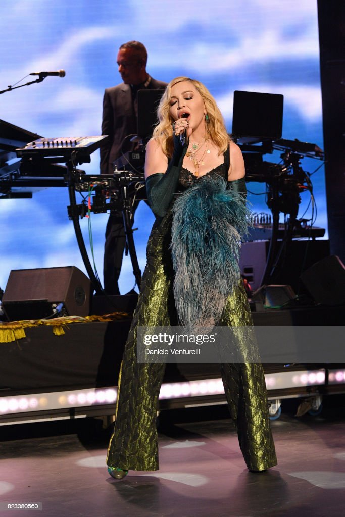 Madonna performs on stage at the Leonardo DiCaprio Foundation 4th Annual Saint-Tropez Gala at Domaine Bertaud Belieu on July 26, 2017 in Saint-Tropez, France.