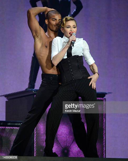 Madonna performs on stage during her 'MDNA' tour with dancer Brahim Zaibat at Ramat Gan Stadium on May 31 2012 in Tel Aviv Israel