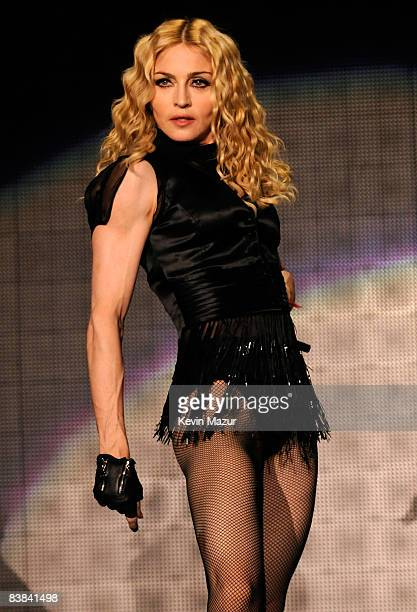 Madonna performs on stage during the ''Sticky Sweet'' tour at Dolphins Stadium on November 26 2008 in Miami