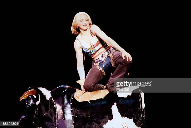 Madonna performs on stage on a bucking bronco on her Drowned World Tour, Earls Court, London, 12th July 2001.