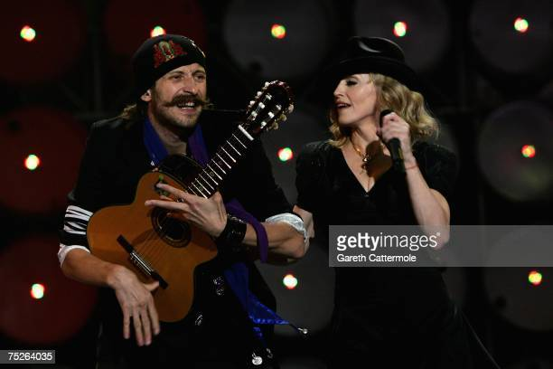 Madonna performs on stage with Eugene Hutz during the Live Earth concert held at Wembley Stadium on July 7 2007 in London Live Earth is a 24hour...