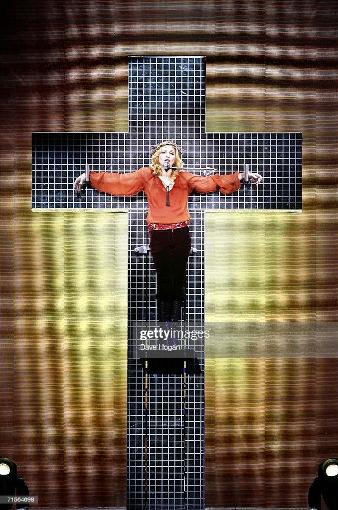 Madonna performs onstage at the first London concert of her 'Confessions' World Tour at Wembley Arena August 1, 2006 in London, England.