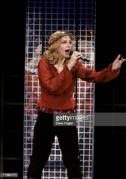 """Madonna performs onstage at the first London concert of her """"Confessions"""" World Tour at Wembley Arena August 1, 2006 in London, England."""