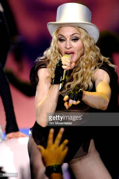 """Madonna performs part of her """"Sticky & Sweet Tour"""" at the Oracle Arena on November 1, 2008 in Oakland, California."""