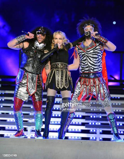 Madonna performs with LMFAO members SkyBlu and Redfoo during the Bridgestone Super Bowl XLVI Halftime Show at Lucas Oil Stadium on February 5 2012 in...