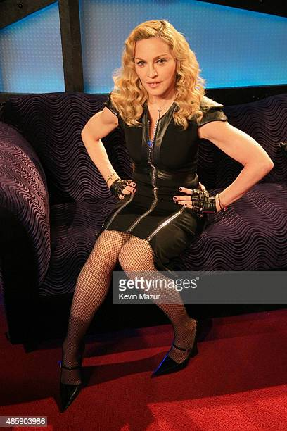 Madonna poses as she appears on The Howard Stern Show on Howard Stern's exclusive SiriusXM Channel Howard 100 at SiriusXM Studios on March 11 2015 in...
