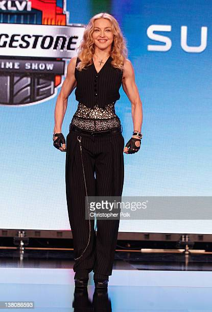 Madonna poses during the Bridgestone Super Bowl XLVI Halftime Show Press Conference at the Super Bowl XLVI Media Center on February 2 2012 in...
