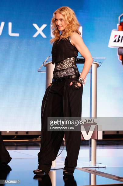 Madonna poses during the Bridgestone Super Bowl XLVI Halftime Show Press Conference at the Super Bowl XLVI Media Center on February 2 2012 in...