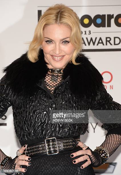 Madonna poses in the press room at the 2013 Billboard Music Awards at the MGM Grand in Las Vegas, Nevada, May 19, 2013. AFP PHOTO / ROBYN BECK