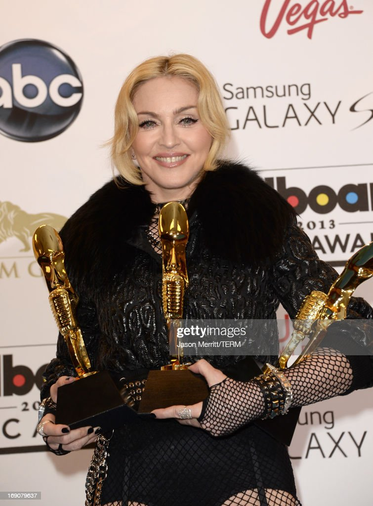 Madonna poses in the press room with the Top Touring Artist Award during the 2013 Billboard Music Awards at the MGM Grand Garden Arena on May 19, 2013 in Las Vegas, Nevada.