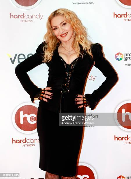 TORONTO ON FEBRUARY 11 Madonna poses on the red carpet during a visit to Toronto's Hard Candy Fitness February 11 2014