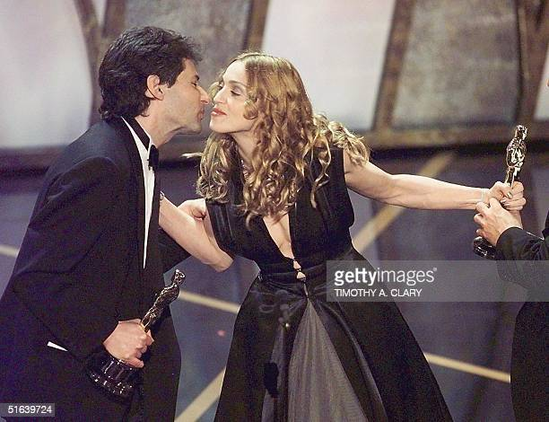 Madonna presents the Oscar to James Horner after he and his partner Will Jennings won in the Best Original Song Category for the song from the movie...