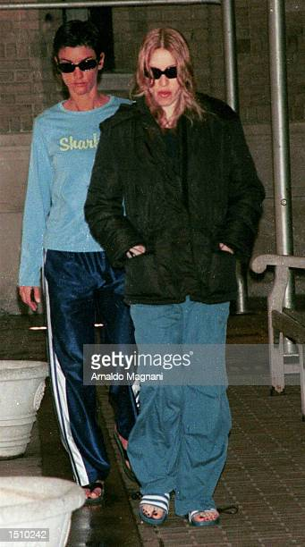 Madonna right and Ingrid Casares both of whom are pregnant walk together on their way to the doctor April 8 2000 in New York City