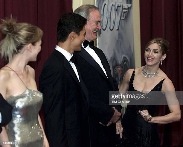 Madonna shares a joke with John Cleese as they wait in line to meet Queen Elizabeth II and The Duke of Edinburgh at the premiere of 'Die Another Day'...