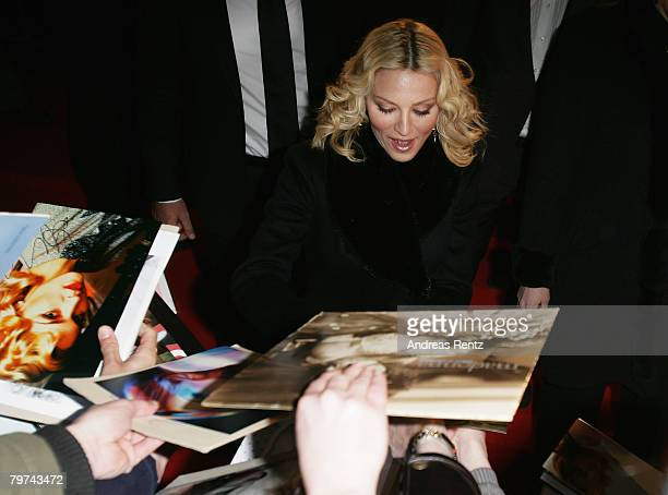 Madonna signs autographs prior to the 'Filth and Wisdom' Premiere as part of the 58th Berlinale Film Festival at the Zoo Palace on February 13 2008...